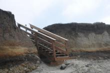 Old set of stairs that were damaged during the winter storms has been repaired with a large base installed at the bottom.