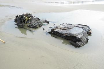 Car remains exposed by 2021 King Tides on Wakonda Beach