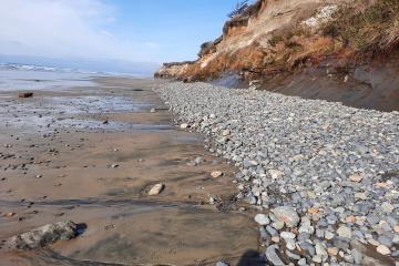 Rocks at base of embankment