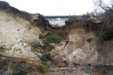 Bluff erosion affecting natural and man-made features