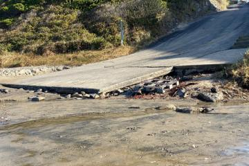 Erosion at NW 15th Street vehicle access, close up view
