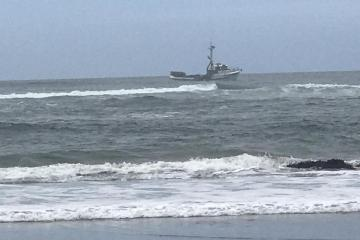 Fishing vessel off beach