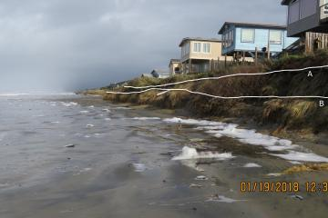 Eroding embankment resulting from extreme surf and high tide.