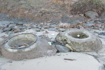Some concrete on the beach-from pipe erosion,