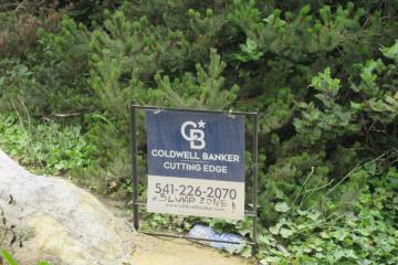 Sign on up from beach. Near Houses-Beach Erosion