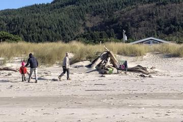People hanging out at the driftwood forts on Nadonna Beach