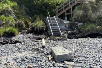Repaired stairs below Oregon Homes