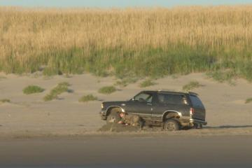 Watched this guy pull up to about a 2.5' tall sand castle someone had made, then back up and make a run at it... here's the result. A county sherriff happened to be driving by a few minutes later and stopped... presumably to administer an IQ test?