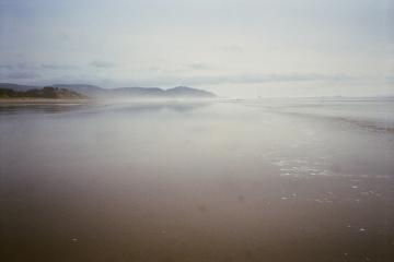 This view is near the surf of a low tide looking south towards the forests at the southern end of Bayocean Spit.