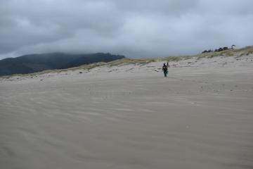 My daughter, Natanya, heads off to the dune area looking for more small debris: plastic bottles, rope, floats, etc.
