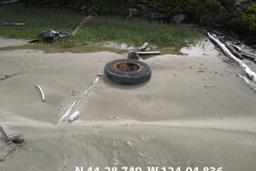 This tire looks to have been in the water for some time,  I do not remember seeing it last year.  Is it newly washed up or is it just unburied?