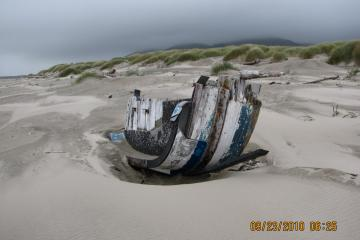 This portion of a hull and front of a boat has been buried in the northern, sandy part of mile 288 for many years.  Slowly it erodes and fades away.