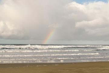 No rain and a beautiful rainbow over the ocean made December 22 special on Nye Beach.