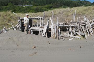 """perennial driftwood """"fort"""" S. entrance to mile 23 at Henry's Rock.Mileman Bob in photo too"""
