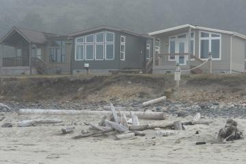 """The Lane County Planning Commission has approved mobile home use of the shoreline land in this RV park. These """"mobile homes"""" are being constructed now. Each home has a foundation, piped water and electrical service."""