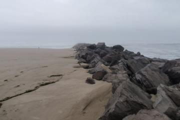 Sand continues to build on Mile 289.  About a decade ago, it was a 10 to 15 foot climb from the beach to the taller rock in the middle of the photo