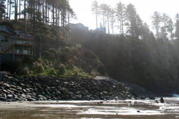 Houses sit precariously on the cliff above a slide area. Huge amounts of riprap boarder the beach. Even during low tide the ocean reached the edge of the riprap at the south end of the beach.