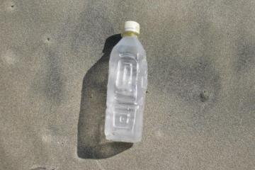 Found many water bottles of this shape/size in the debris field.  Though they have no markings, they are certainly not local.  Actually, they remind me of the typical water bottles used in Peru and Ecuador.