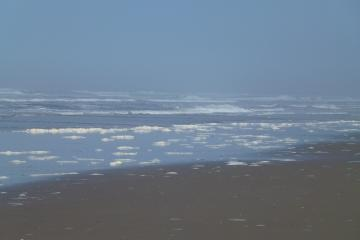 Seafoam in area around Surfland parking lot which extended northward to just below South Beach Park.