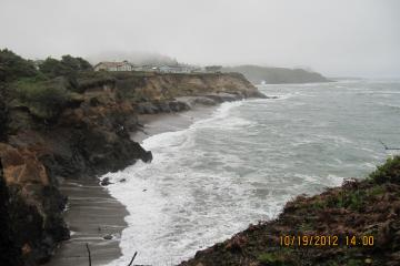 Looking south from Fishing Rock on a misty gray day as the time comes in.