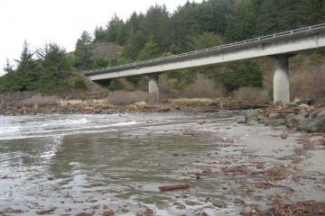 Myers Crk marks N end of mile 23: surf pushing under 101 bridge in creek channel. King tide