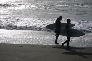 Surfers take advantage of the waves on New Years Day