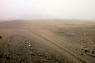 Snowy Plover fence being covered by sand in several places.  Photo was taken in rain - hope you can see.