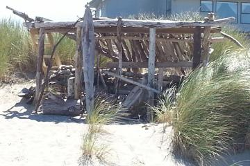 Someone got a little creative with the use of driftwood!  Structure probably will not survive the winter storms.