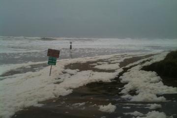 Large amounts of sea foam in area usual having little.