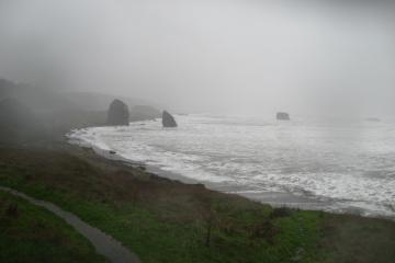 Looking South with a wave at its highest reach toward shore.  The following photo was taken from a spot directly opposite the onshore monolith