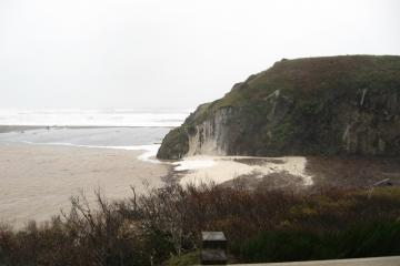 It appears that waves have overtopped the spit west of the muddy lagoon with force (and wind) enough to splash foam (the whitish deposit)straight up the east face of Henrys Rock! I did not see it happen.