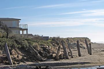 This is where Saltair Creek enters the beach, on the north side of the property. The vertical logs held piles of horizontal logs until a couple of storms this winter washed them away.