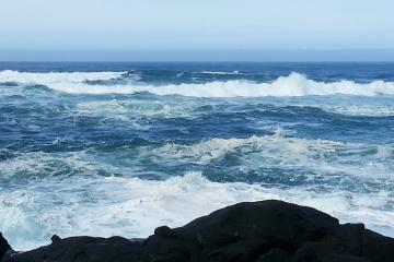 Looking out from Fishing Rock on a calm day with stormy seas.