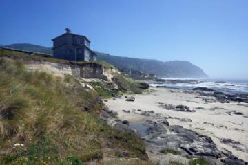 View of eroded bluff and house and end of Mile 193 looking toward Yachats State Park.