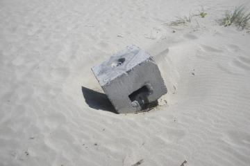This is a close up of on of six concrete blocks found on the beach.