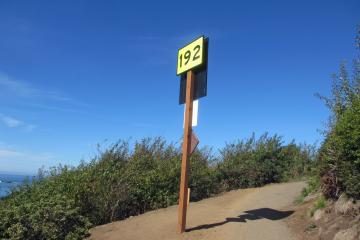 Mile 7, One of the several hundred Oregon Safety Signs which pinpoint (GPS) locations along the Oregon coast for emergency response. Most of these signs are located near beach access points.