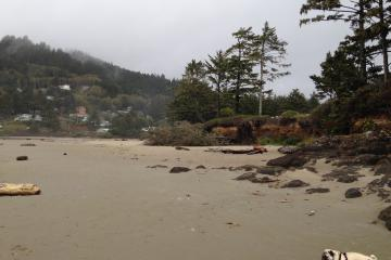 Erosion seen from beach approaching mouth of Yachats River from the south