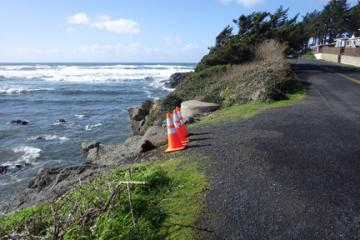 Warning cones along Ocean View Drive on north side of river