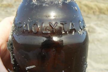 Brown bottle with the works Paolyta Co. on it. Said to be energy drink from Asia.