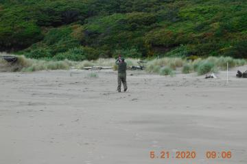 Ranger Doug pounding poles in sand