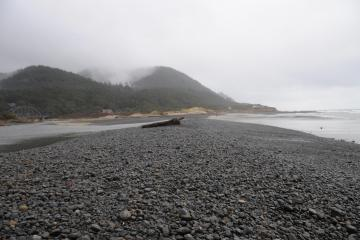 Rocks deposited at outlet of Tenmile Beach