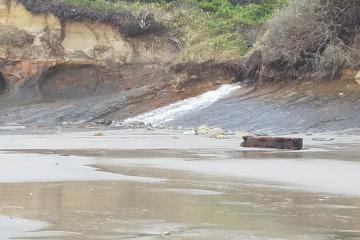 water draining on beach